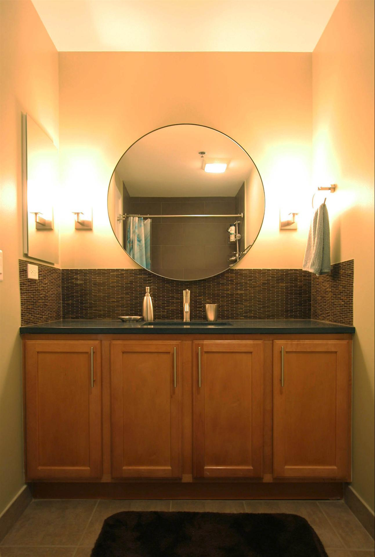 Custom Built Vanity With Circular Mirror And Recessed